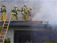 Firefighters on roof